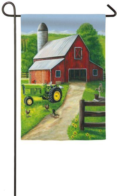 Tractor in a Barn Garden Flag